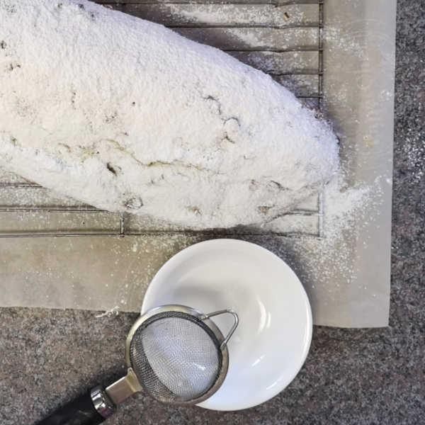 German Quark Stollen: Dust warm stollen with powdered sugar  #christmas #germanrecipes #justlikeoma https://www.quick-german-recipes.com/stollen-recipe.html