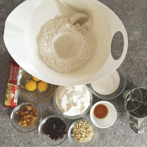 German Quark Stollen: add dry ingredients to bowl #stollen #christmas #germanrecipes #justlikeoma https://www.quick-german-recipes.com/stollen-recipe.html