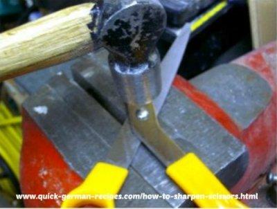 smack the rivet head lightly on the scissor