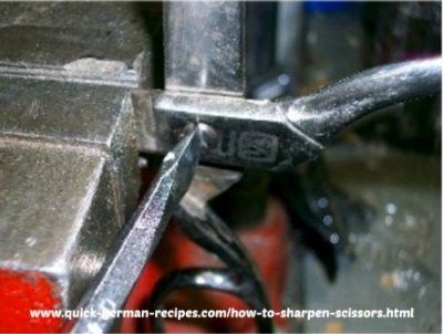 Here's how to make a screw hinged joint on scissors