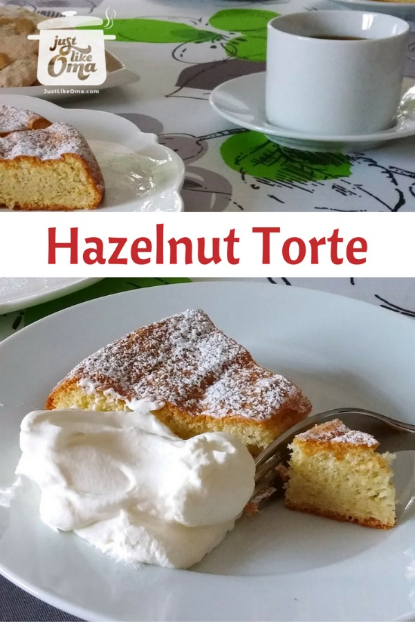 White plate with piece of Hazelnut Cake served with a dollop of whipped cream