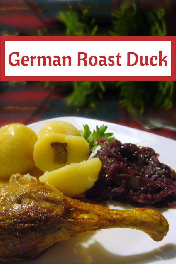 Traditional German Christmas Duck Dinner with roast duck, potato dumplings, red cabbage and lots of gravy!