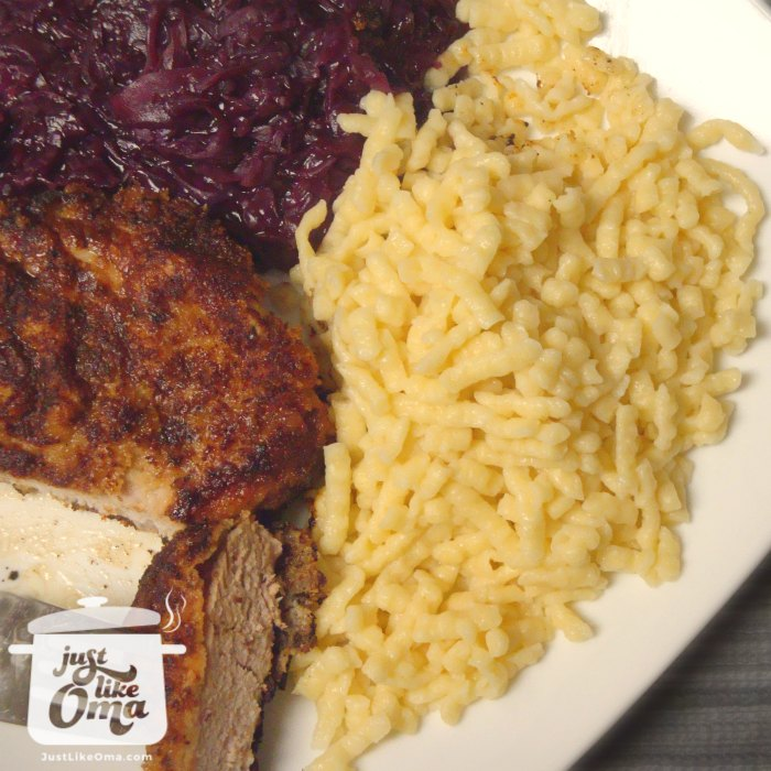 white plate of Spätzle, red cabbage and breaded pork chops
