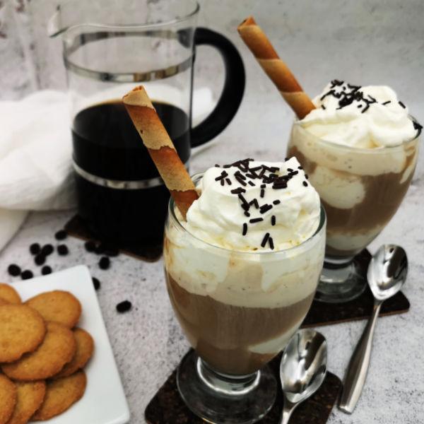 Glass of iced coffee, German-style with whipped cream