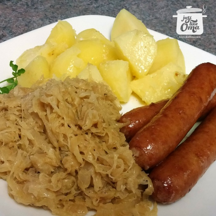 Baked sausages with boiled potatoes and sauerkraut
