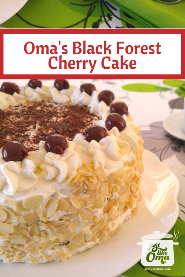 Traditional Black Forest Cherry Cake with slivered almonds on the sides.