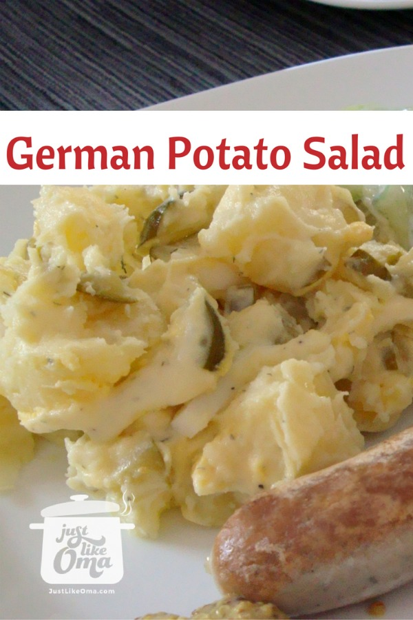 Plate with German potato salad, sausages, and cucumber salad