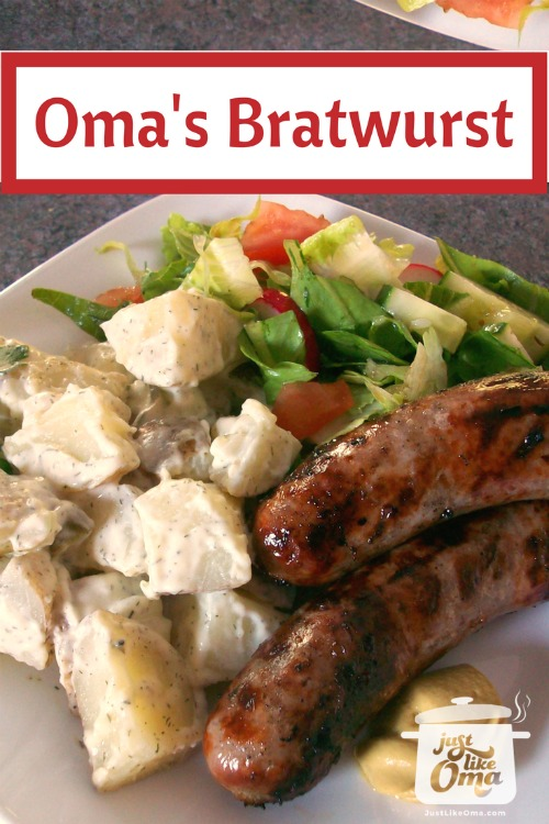 plate with bratwurst, German potato salad and tossed salad