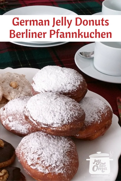 Plate of German Christmas cookies including Lebkuchen, Hazelnut Macaroons, and Berliner Pfannkuchen.