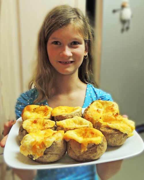 My granddaughter, Lydia, and her first attempt at making twice baked potatoes.