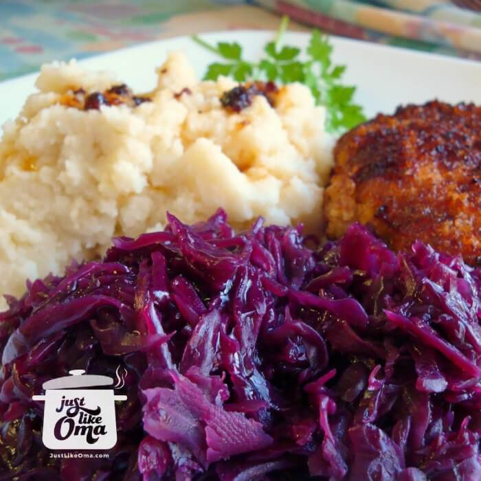 Plate with German Red Cabbage and breaded pork chops with mashed potatoes.