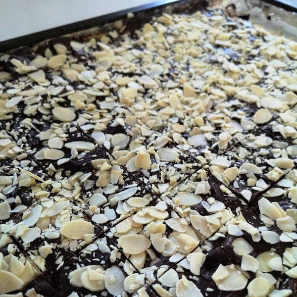 Making Skor Bar Cookies ... add nuts, cool, and cut. Enjoy!