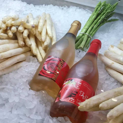Traditional German white asparagus sold in the farm stores displayed with wine.