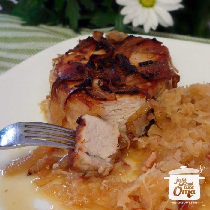 plate with baked pork chop and sauerkraut