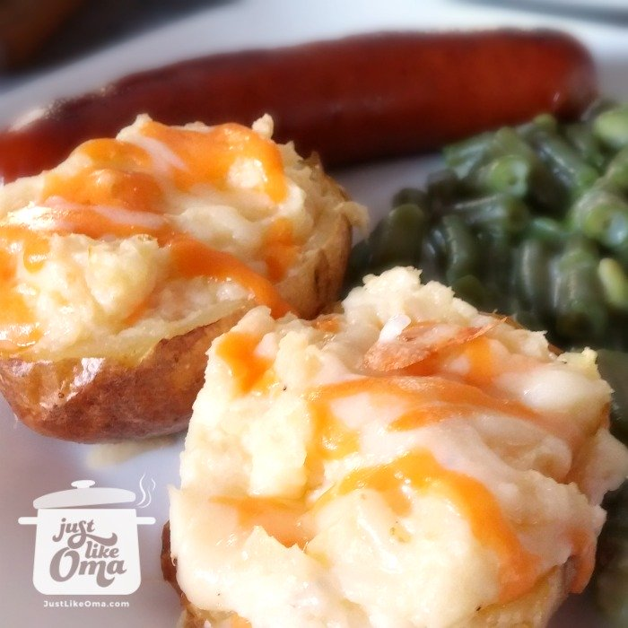 plate with twice baked potatoes stuffed with cheese, creamed green beans and sausage