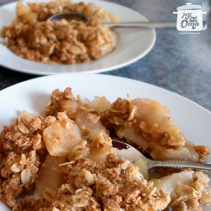 white plates with Oma's Best Apple Crisp with oatmeal crunch topping