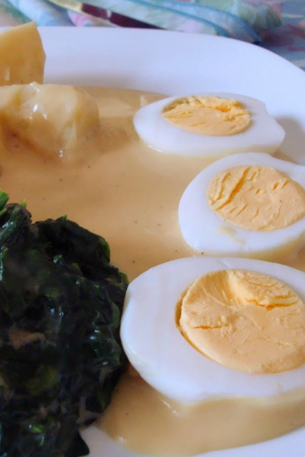 ❤️ German Eggs with mustard sauce. Usually served with boiled potatoes & creamed spinach.  https://www.quick-german-recipes.com/eggs-with-mustard-sauce.html #eggs #mustardsauce #germanfood #justlikeoma