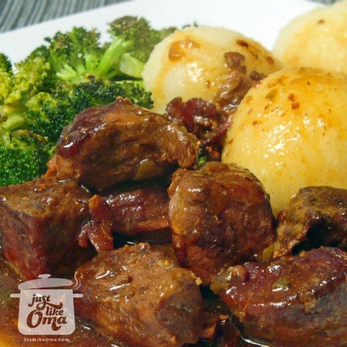 Plate with beef flatladen (that taste just like rouladen), potato dumplings, and steamed broccoli and wonderful rouladen gravy