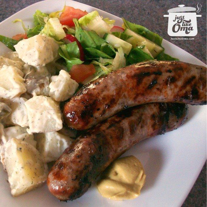 plate with bratwurst (sausage) and German potato salad