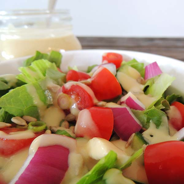 If you love hummus, then you'll love this creamy hummus salad dressing recipe! Perfect on many dishes.