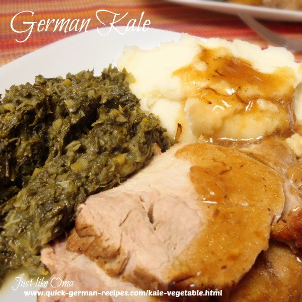 Creamy kale served with mashed potatoes, roast pork and gravy