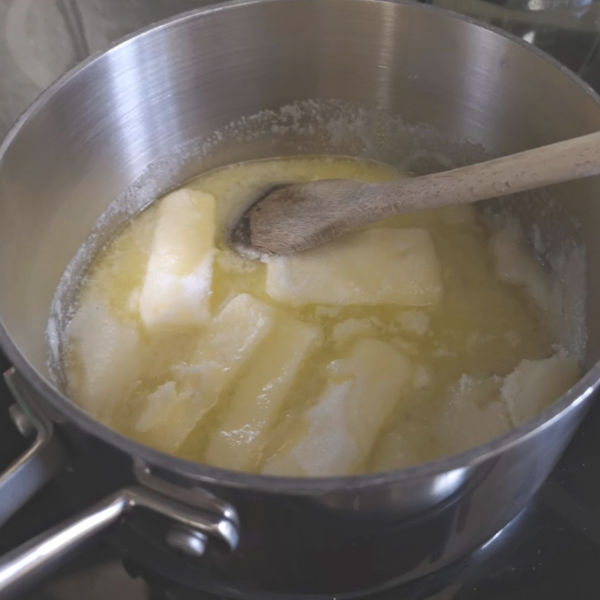 Melting butter and sugar for pecan bars