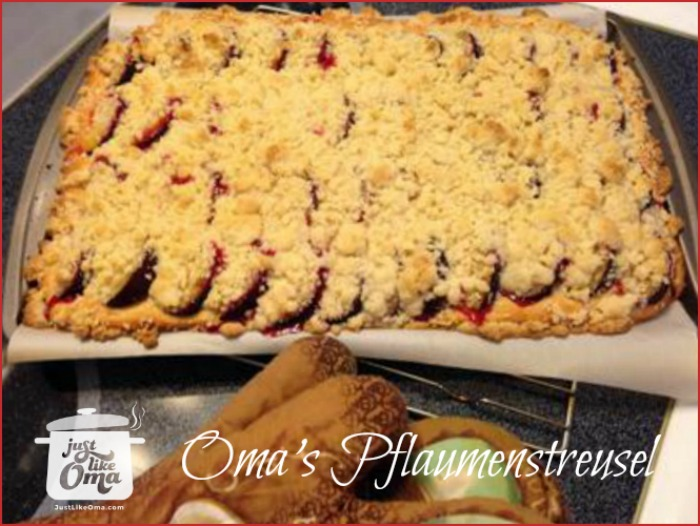 cookie sheet with plum cake with a crumble topping ready to be served
