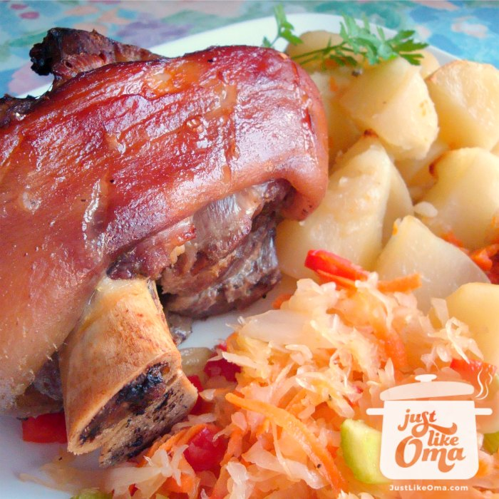 Crispy skinned German Pork Hocks served with boiled potatoes and sauerkraut.