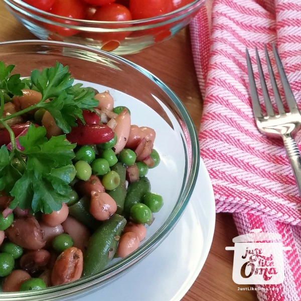 bowl of 3+ Bean Salad served with cherry tomatoes